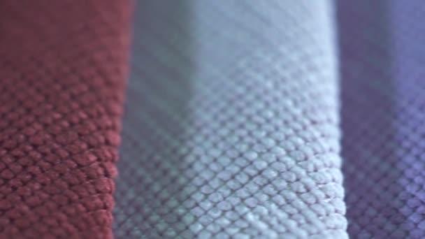 Hochwertige Stoffe, verschiedene Farben von Textilien Makro Makro