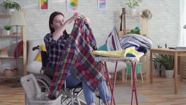 young disabled woman housewife washing clothes ,housework
