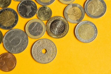 Coins of the various countries. many metal coins of different denominations and different countries. finance background