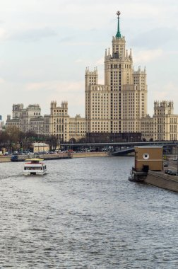The view of embankment , Moscow river and Kotelnicheskaya Stalin`s Skyscraper in Moscow, Russia, one spring day, vertical.