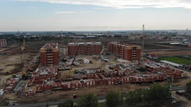 4k Aerial view of the construction site. Construction of houses. Tower crane.