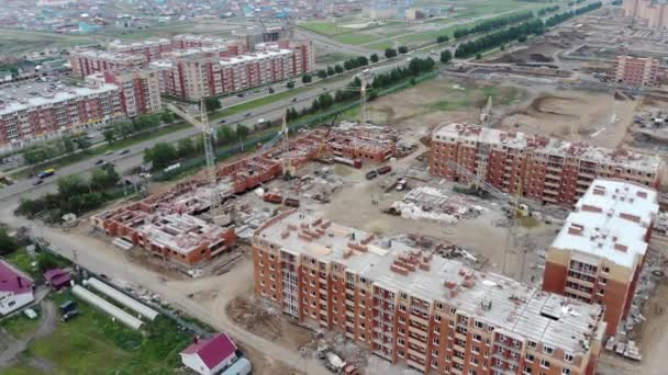 4k The production process of building houses. Construction site of residential buildings.
