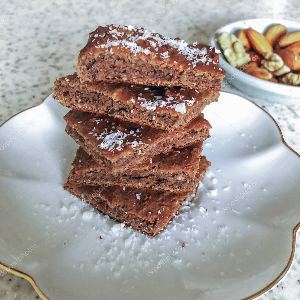 Nutritious brownie with nuts sprinkled with oat flakes. Health food. Fitness food