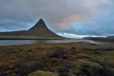 Iceland. Beautiful summer landscapes overlooking the mountain Kirkyufetl