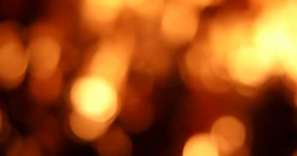 Tűz bokeh élénk piros és narancs körökben. Gyönyörű tűzháttér