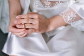 Engagement ring on brides finger. Wedding day.