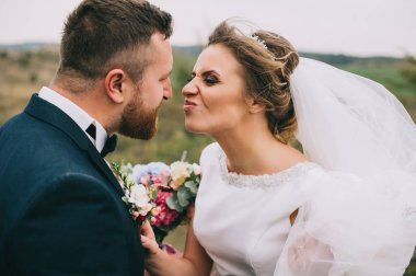 beautiful happy young wedding couple making funny faces