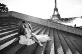 Happy romantic married couple hugging near the Eiffel tower in P