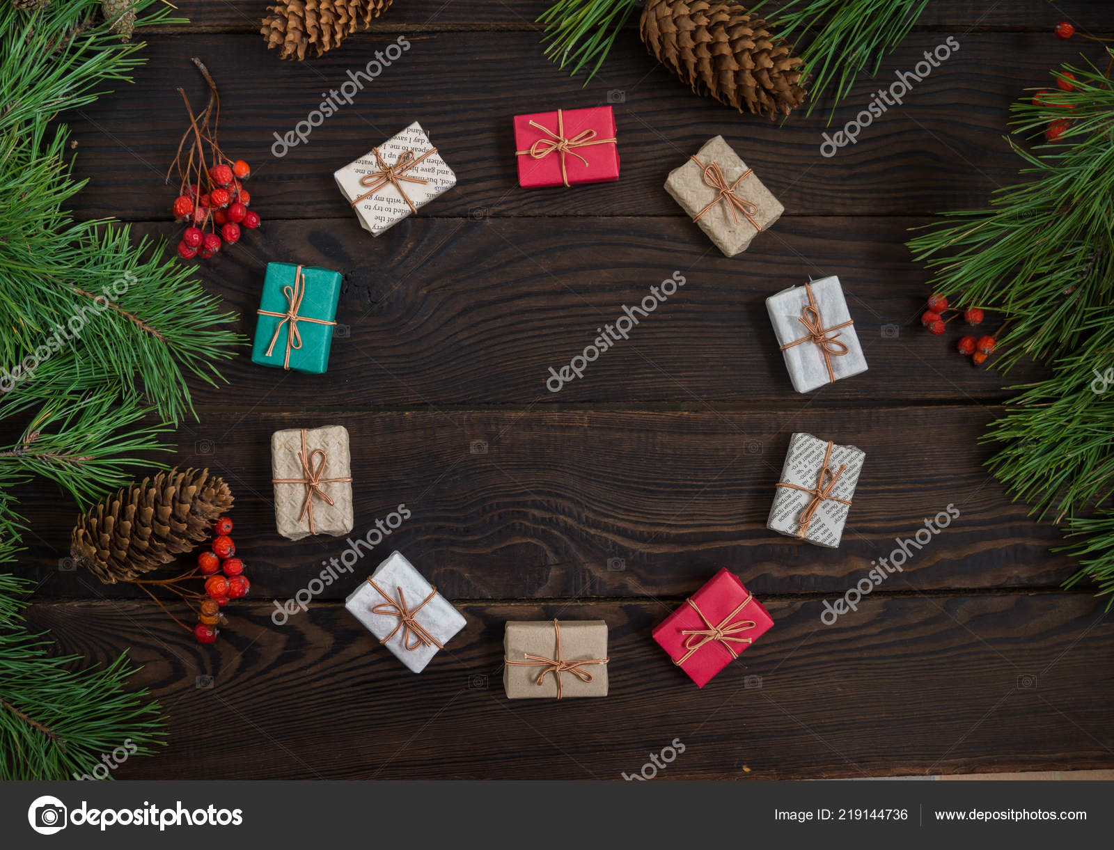 Multi Colored Boxes Christmas Gifts Pine Branches Wooden Surface