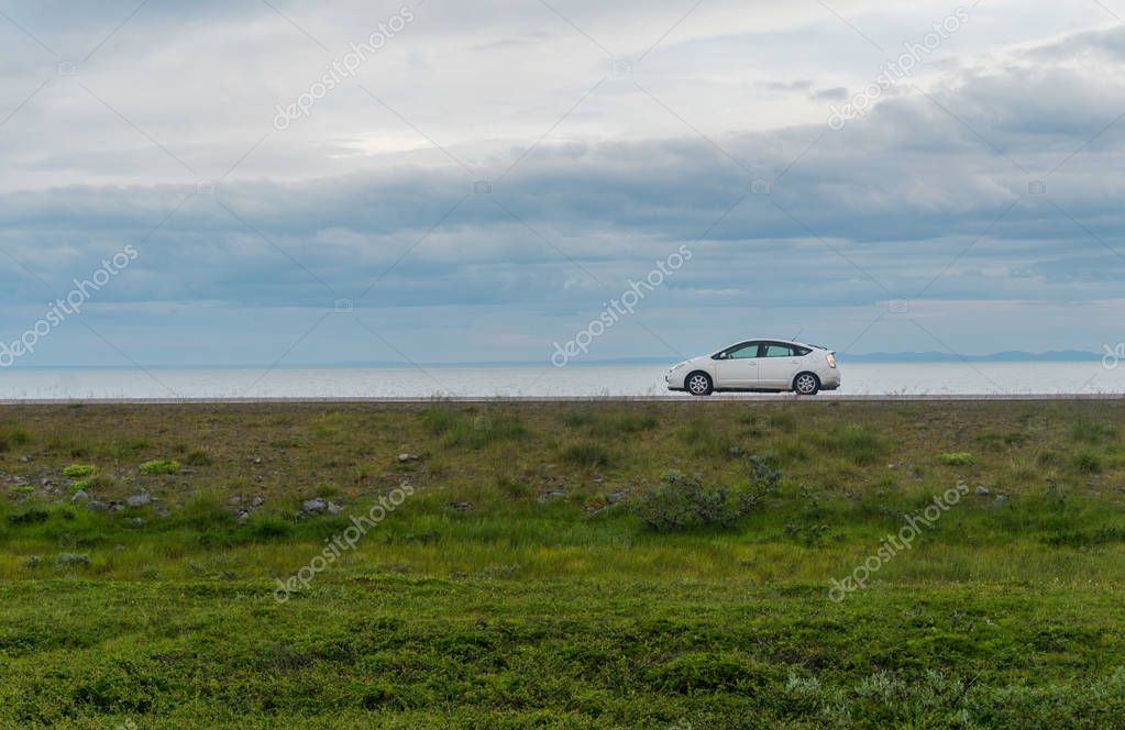 FINNMARK, NORWAY - AUGUST 12, 2017: White car on National tourist route Varanger