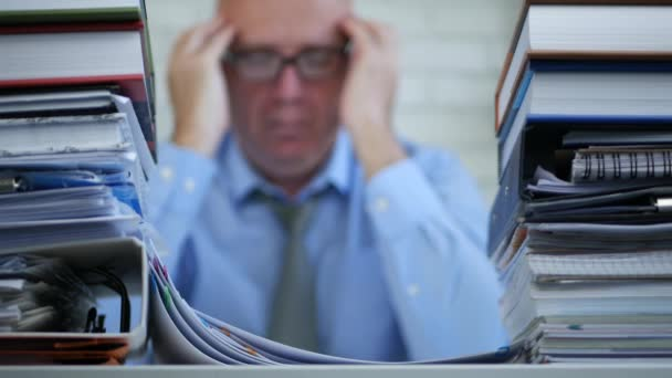 Blurred Image With Businessman In Office Room Suffering a Terrible Headache