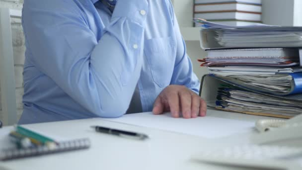 Pensive Businessman in Office Thinking and Gesturing with Fingers on the Table