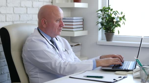 Doctor Working in a Medical Cabinet Use Laptop Online Connection