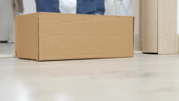 Man Open a Door and Take a Cardboard Box Delivered Buy Postal Courier