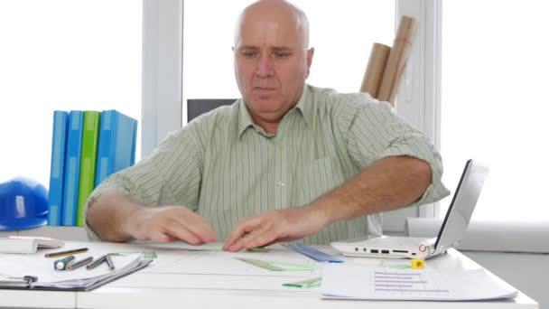 Engineer with Drawing Tools in hands Making Technical Projects and Plans