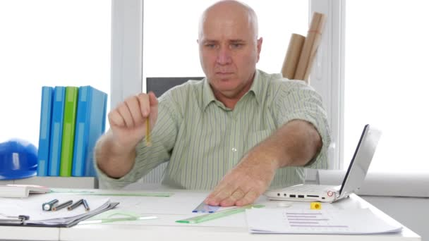 Engineer Working with Drawing Tools Making Technical Projects in Office Room