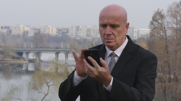Slow Motion Serious Businessman Talk to Mobile and Gesturing Outside Office