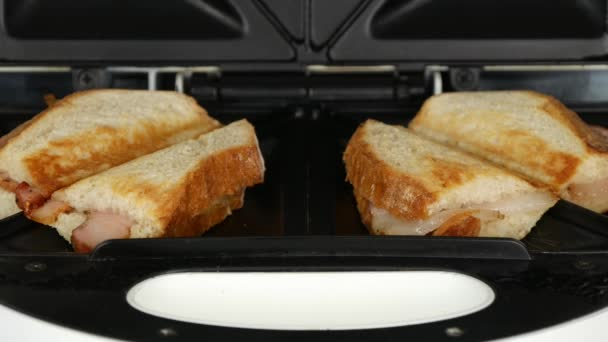 Two Tasty Roasted Sandwiches with Smoked Ham and Bread Made in Electric Grill