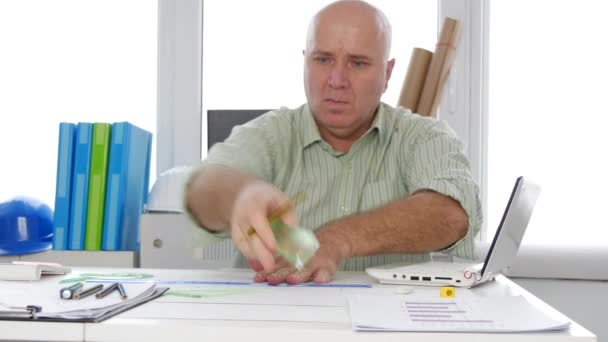 Engineer Working in a Design Office Drawing a Technic Plan on Design Table (Ultra High Definition, UltraHD, Ultra HD, UHD, 4K, 3840x2160)