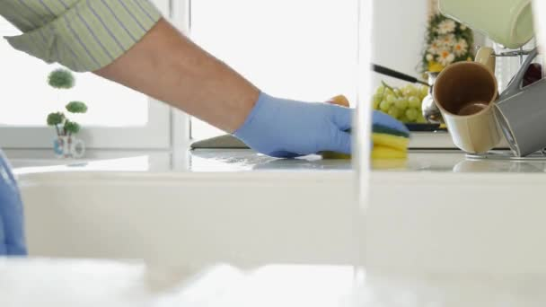 Man with Cloves Detergent Water and Sponge Clean in Kitchen  (Ultra High Definition, UltraHD, Ultra HD, UHD, 4K, 3840x2160)