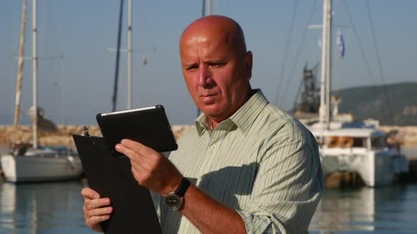 Sales Agent Working in Tourism Compare Data from Clipboard and Touch Tablet