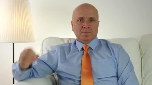 Presentable Businessman Sitting in Meeting Room Showing Ok Good Job Hand Sign