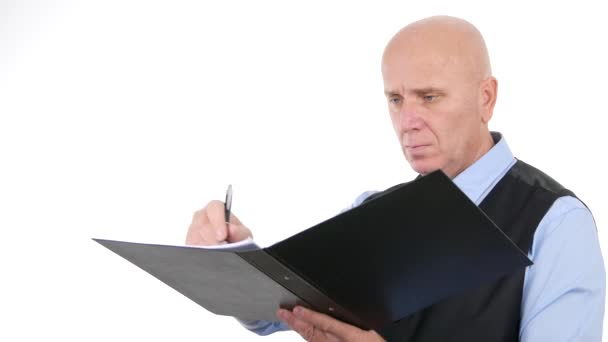 Confident Businessman Read and Take Notes in a Business File Documentation.