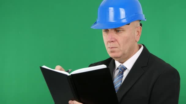 Confident Businessman Engineer Wearing Black Suit Write in a Work Agenda.