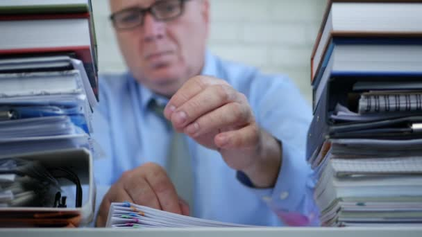 Businessman Blurred Image in Office Fill Documents and Take Out Eyeglasses Tired