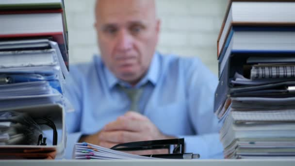 Blurred Image with Sad Businessman In Accounting Office