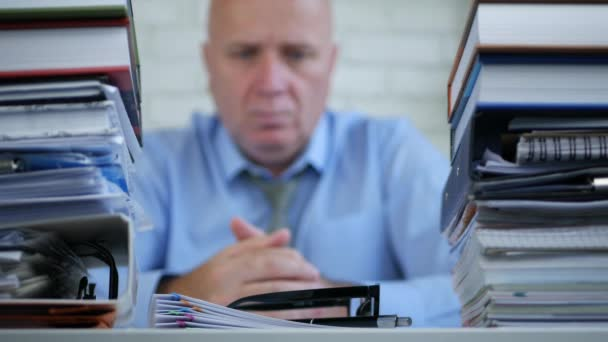 Blurred Image With Businessman Tired and Concerned Thinking Pensive in Office
