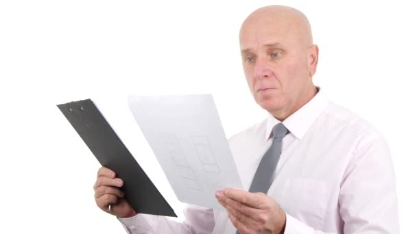 Businessperson Read and Compare Documents from a Clipboard