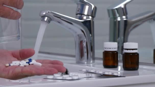 Man Preparing to Take a Lot of Pills with Fresh Water