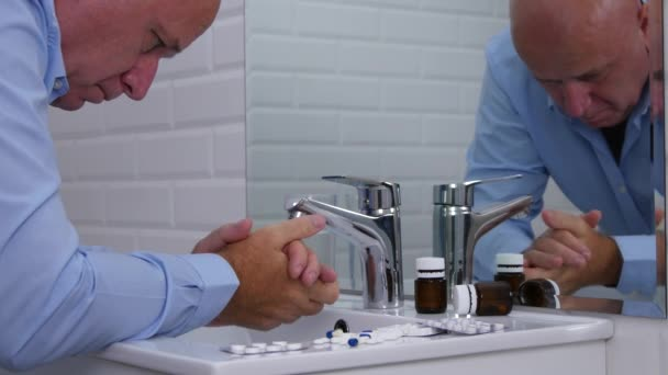 Trouble and Disappointed Businessman in Bathroom Looking to a lot of Pills