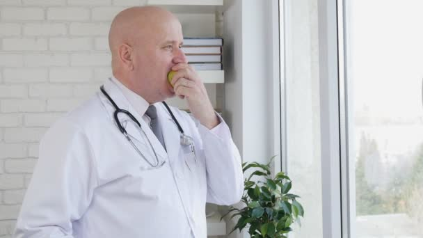 Slow Motion with Doctor in Hospital Office Take a Pause Eating a Fresh Apple