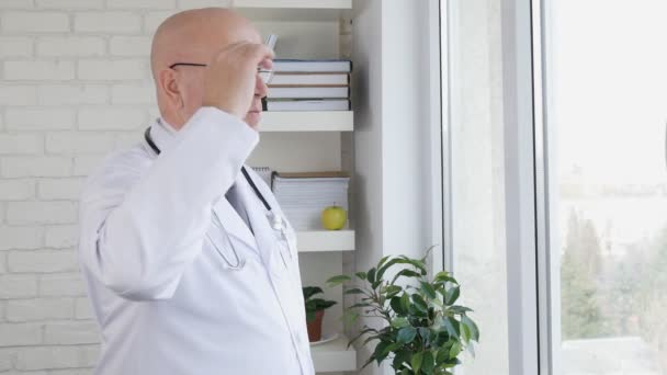 Slow Motion with Confident Doctor Thinking Pensive Inside Medical Cabinet