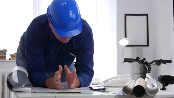 Engineer Working in Office Analyze and Study Plans and Projects