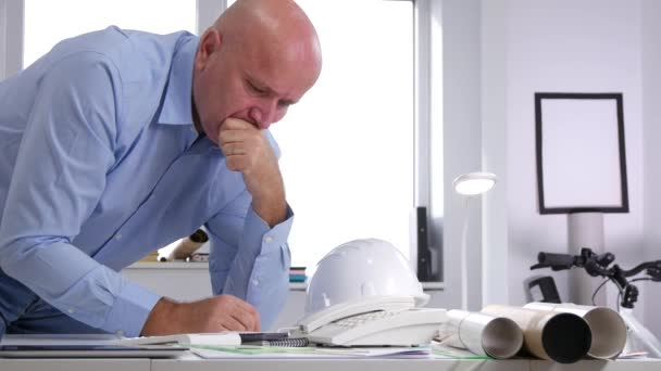 Engineer Looking Worried to Some Technical Projects and Gesticulate Disappointed