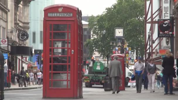 London Image with Traditional Phone Booth on a Crowded Street