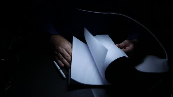 Businessperson in Dark Room Browse Register Pages Looking for Information