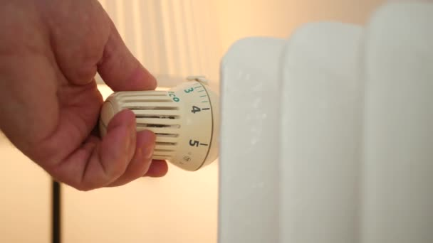 Shooting with Man Hand When Set the Radiator Thermostat Temperature Value