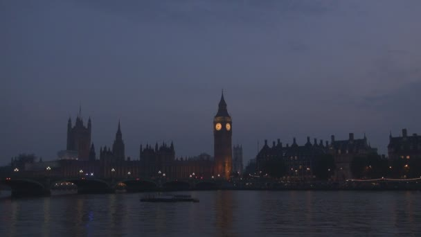London Night View Westminster Palace Big Ben and Emergency car Crossing a Bridge
