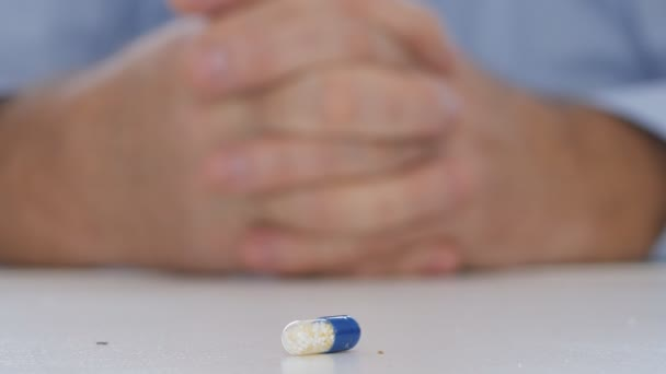 Doctor Image with a Colored Vitamin Pill on the Table Recommending Health Cure