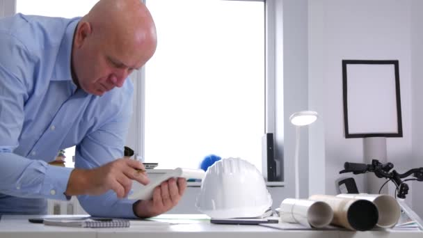 Busy Businessman Make Calculations Using Adding Machine in Office