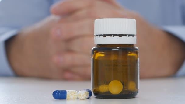 Impatient Doctor Presenting Colored Pills Vitamins and Antibiotics