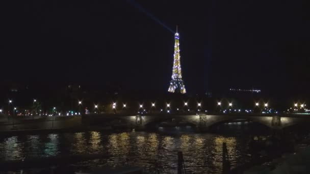 Paris In Night With Eiffel Tower Lighted and Seine River Water Reflection