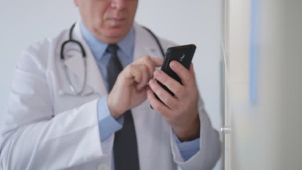 Slow Motion with a Doctor Talking to Cellphone and Searching Medical Contracts
