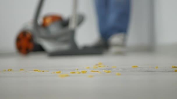 Close Up Shooting with a Man Using Vacuum Cleaner to Clean Dirt from the Floor