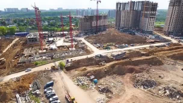 Drone flies over a construction site near Moscow. Construction cranes in the industrial zone. Building a new area.