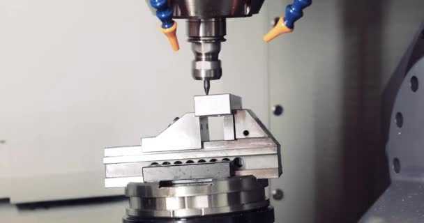 Cnc milling machine. Processing and cutting of parts from a piece of metal in the industrial area. Industrial exhibition of machine tools.